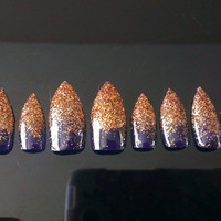10 press on purple and gold glitter stiletto nails to fit medium nail beds.
