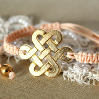 Friendship bracelet celtic knot peach braided 14k gold plated .