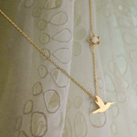 gold bird necklace with flower charm