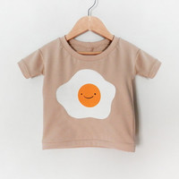 EGG / COCO baby and kid shirt. 3-color screen print on soft beige organic cotton. 6-12m / 12-18m / 2T / 3T / 4T