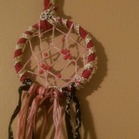 Handmade medium-small sized dreamcatcher.
