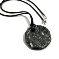 Polymer clay round pendant necklace black, white and silver mokume