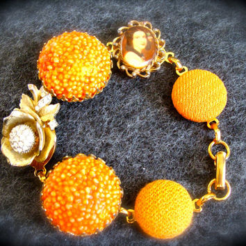 VIntage earring Bracelet Orange with Upcycled 1960s earrings, buttons & cameo