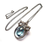 Wire wrapped Silver pendant, Swiss blue Topaz, natural gemstone, luxury oval necklace in light pastel blue