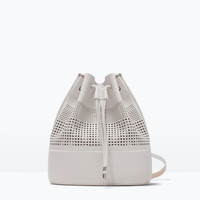 Perforated bucket bag