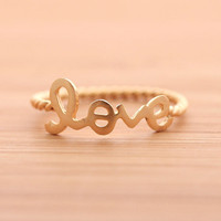 LOVE with twisted band ring, in gold