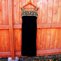 vintage black and gold boutique evening gown with back drape. size M