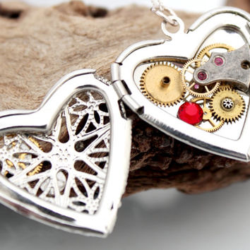 Steampunk locket silver plated filigree heart with red Swarovski crystals, wing and vintage watch parts- Unique jewelry