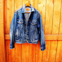 vintage Levis stonewash denim jacket. red tag. size 44. unisex