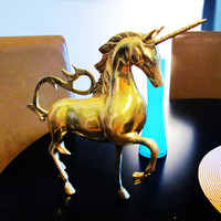 large brass unicorn. ornate Hollywood Regency style. Renaissance. made in India