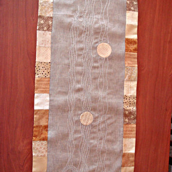 Patchwork table runner with a sashiko embroidery. Beige table topper