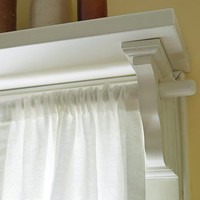 put a shelf over a window and use the shelf brackets to hold a curtain rod!