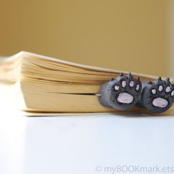 Cat paws .Bear paws in the book. Unusual art bookmark. Funny gift. Cat in book for child, children, kids, for her, all, hostess. oht