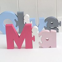 freestanding name puzzle by kate brunt handmade cards & gifts | notonthehighstreet.com