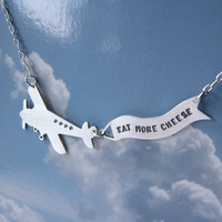 Message in the Sky  silver airplane with banner by melaniefavreau