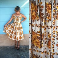 1950s. golden roses spaghetti strap sundress with full skirt. xs