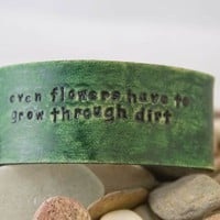 $14.00 Leather bracelet &quot;even flowers have to grow through dirt&quot; by MichelleVerbeeck on Etsy