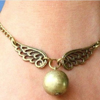 Steampunk Enchanted Golden Snitch wings bracelet