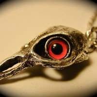 Bird Skull with red eyes Silver Plated Skull On a by billyblue22