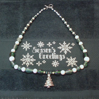 Handmade Beaded Necklace in Aqua Green and White with a Silver Christmas Tree