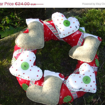 Christmas wreath with mini stockings and hearst in green, red and white for door wall oe table top decoration
