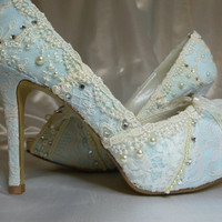 Something Blue ...baby blue lacey wedding shoes..you choose the style and height.
