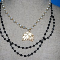 Vintage Inspired Faux Pearl and Black beaded ooak necklace with gold leaf pendant, Statement necklace in cream , black and gold
