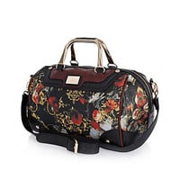 black baroque print bowler bag