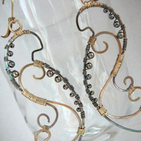 The Linear Peacock earrings - sterling silver and brass