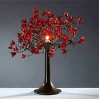 Table light. Red flowers.