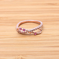 wide INFINITY ring with rubys, in pinkgold | girlsluv.it