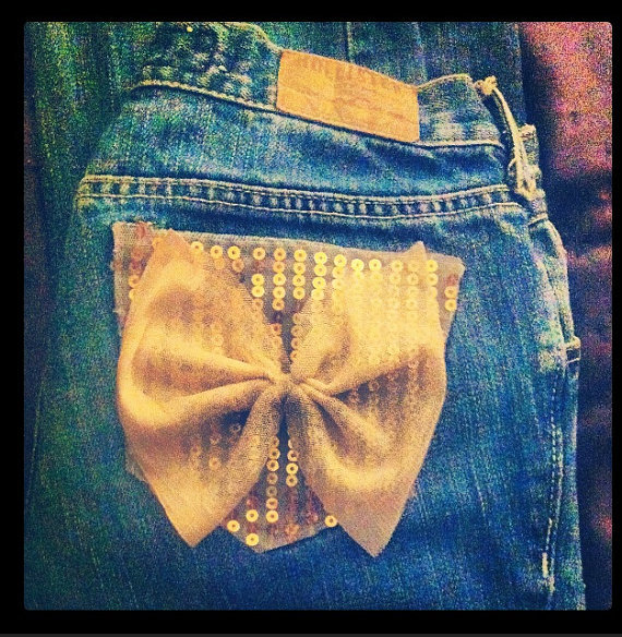 Distressed jeans with sequin and bow accents