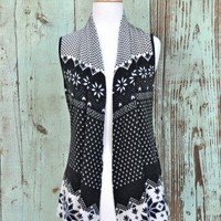 Snowflake Vest - $38.00: From ourchoix.com, this shorter in the back and long in the front open knit vest is adorned with snowflakes.