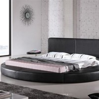 Round Bed | Cool circular leatherette bed, covered in vinyl and perfect for any swanky bedroom.
