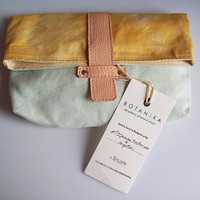 Handmade plant-dyed eco-conscious clutch in mint and yellow