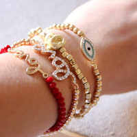 Anthology27, Sweet bracelet with a buddha charm and gold beads