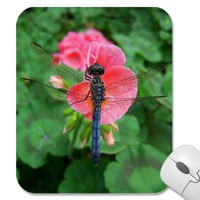 Blue dragonfly on pink flower green background mouse pad from Zazzle.com
