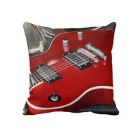 Red guitar on amp throw pillows from Zazzle.com