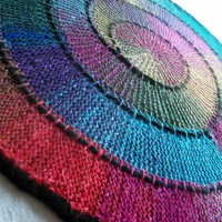 Hand knitted rainbow effect silk and wool spiral blanket by knitonefelttwo