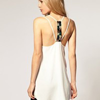 River Island | River Island Silky Swing Cami With Sequin Back at ASOS