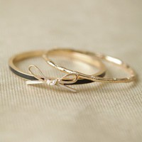 tied with a bow bangle set at ShopRuche.com