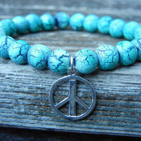 Beaded Stretch Charm Bracelet with Turquoise Beads and Silver Peace Sign Charm