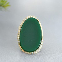 Crystal Moss Ring - $16.00: From ourchoix.com, this dark green stone is framed in gold with tiny crystals. Creates a perfect holiday ring.