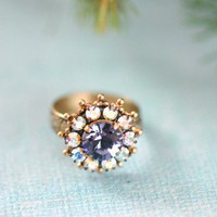Moonlight Magic Ring - $24.00: From ourchoix.com, this sparkling moonlight inspired Swarovski crystals are framed with an icy blue crystal.