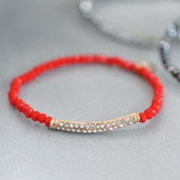 Radiant Red Crystal Bracelet - $15.00: From ourchoix.com, this smoke red crystal dazzles around a thin stretchy bracelet.