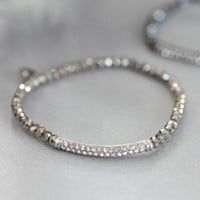 Silver Crystal Bracelet - $15.00: From ourchoix.com, this sparkling silver colored bracelet is dazzling with crystals around small stones.