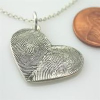 Wedding Ideas / one half is your fingerprint the other your spouse. LOVE!