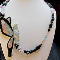 Swarovski Crystal Necklace With But.. on Luulla