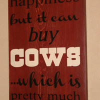 Money can't buy happiness but it can buy Cows - wall sign