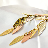Long dangly falling leaf earrings in shades of metal